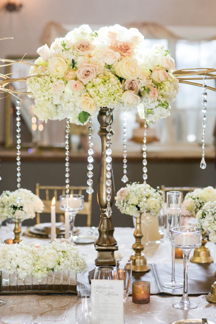 Formal floral and crystal wedding reception table