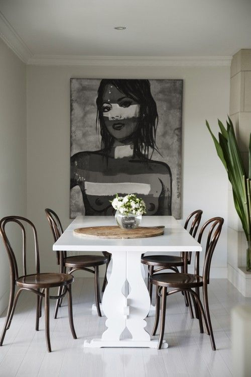 Dining: white table, brown Thonet chairs, black and white David Bromley painting, white floorboards