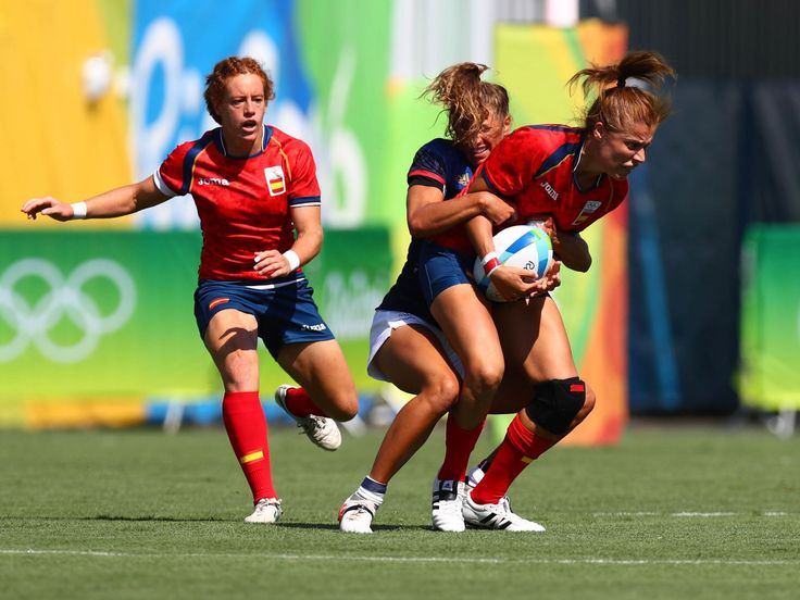 France back Lina Guerin tackles Spain back Vanesa Rial during a rugby sevens match at Deodoro Stadium during the Rio 2016 Summer Olympic Games.  Guy Rhodes, USA TODAY Sports