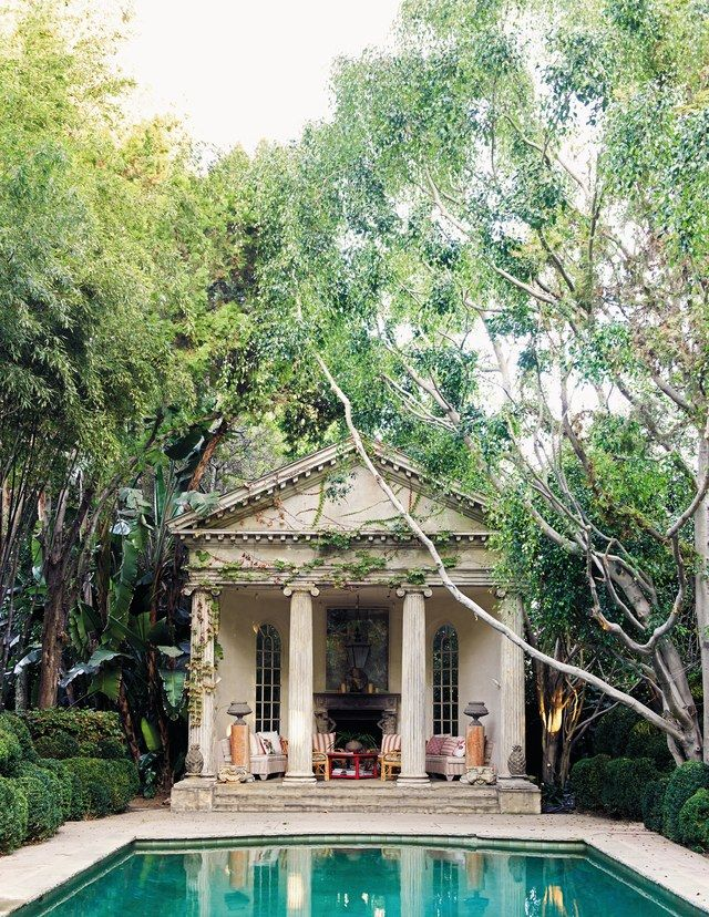 The garden folly's design is based on Andrea Palladio's drawings for the portico of Villa Chiericati in Italy. Its Ionic columns and pediment resemble stone but are made of redwood and fiberglass and distressed to look old.