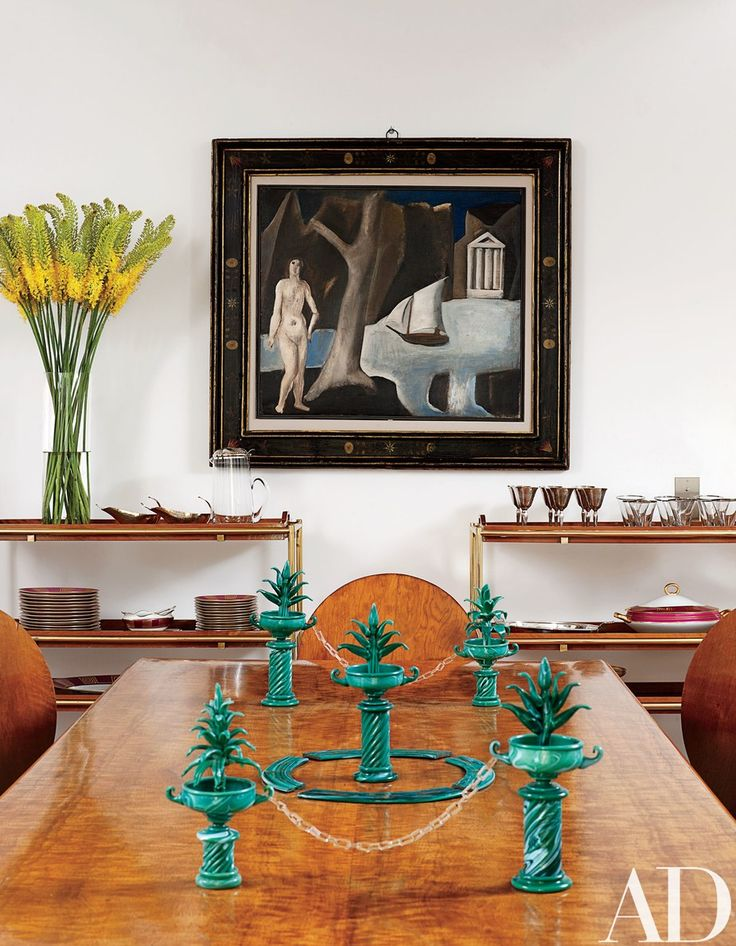This set of circa-1925 Murano-glass-and-paste tabletop decoration by Napoleone Martinuzzi seen in the eclectic Roman home of Carla Fendi is not only a conversation starter, it's also fitting to span a long dining table | archdigest.com