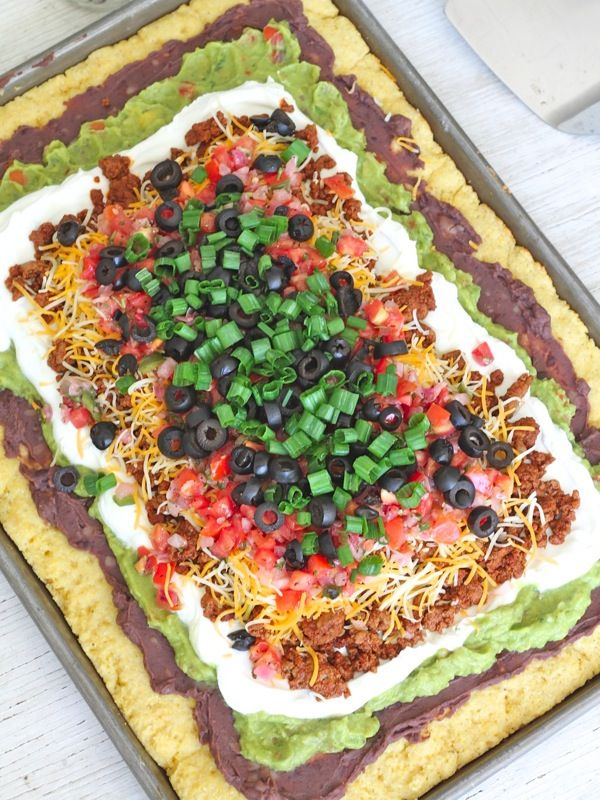 Hosting a party this weekend? Try a large pan of this tasty cornbread topped with everyone's favorite dip for the perfect appetizer. This amazing 7-Layer Cornbread Casserole is sure to be a hit!