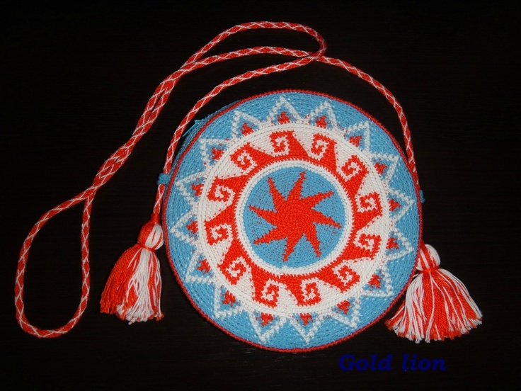 Medallion-style crocheted purse with tassel detail.