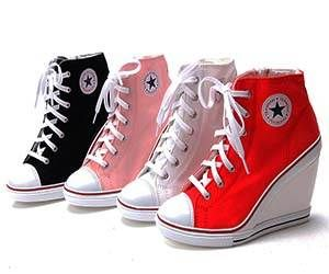 Converse Wedge Heels $32.00  maybe... I can't even walk with regular shoes on but these are cool :]