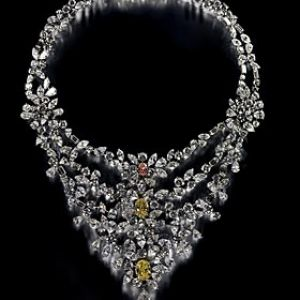 The most expensive piece of jewelry is a stunning necklace that belongs to Marie Antoinette. The dazzling necklace is adorned with numerous white diamonds along with two rare yellow diamonds in oval shape, and on stunning exceptional pink diamond at the bottom. The diamonds are perfectly set on the platinum and weigh 8.05-carat. The white pear shaped diamond is set like a droplet at the bottom and weighs 7.06-carat alone, and the rare yellow diamonds weigh 5.24-carat.