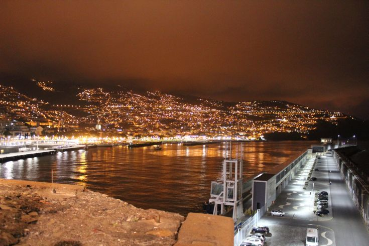 Madeira - Funchal. The harbour at night seems to glow in the misty half light. I dined at the Nini Design Center which is situated in a medieval fortification on the harbour wall, from which this photo was taken. Great views and even better cuisine!
