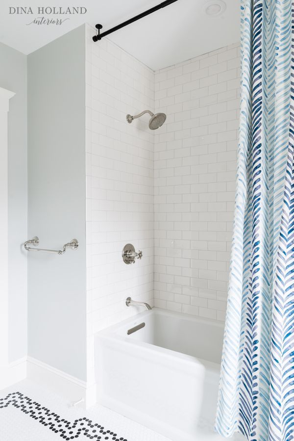 Ceiling-mounted curtain rod for shower curtain. Maybe use two curtain panels at each end rather than one long run?