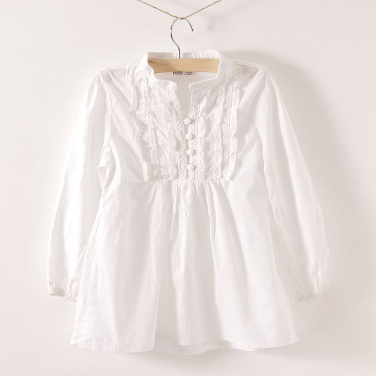 White girls blouse with ruffles.