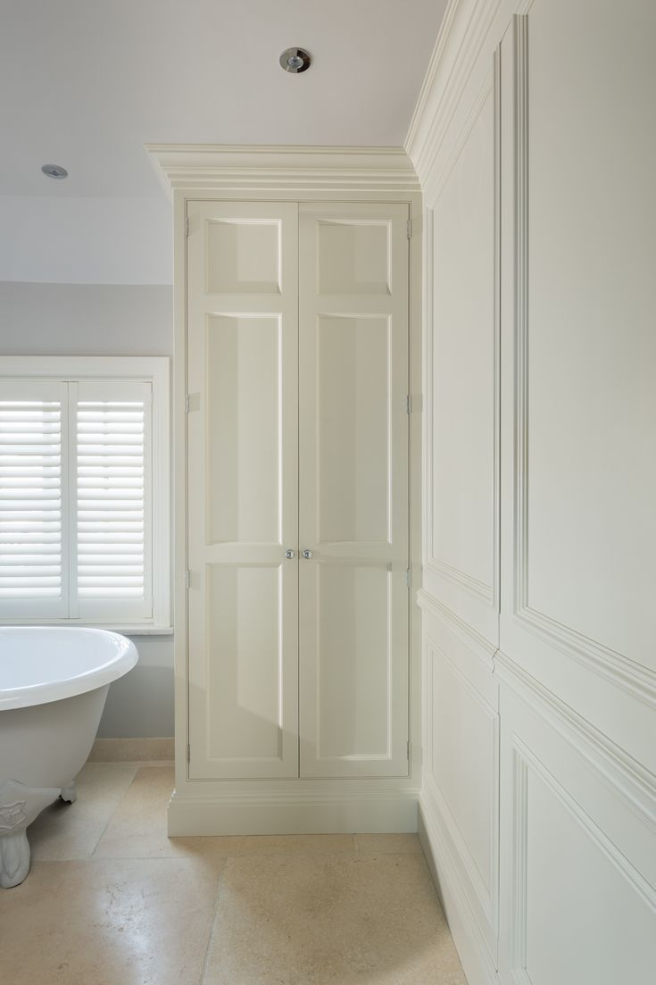 Bespoke linen cupboard with traditional wall panelling   Bathroom ...
