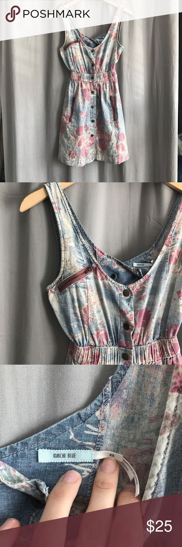 Urban Outfitters • Denim Floral Dress Urban Outfitters Kimchi Blue denim button down dress with all over Floral print. Zipper accents and Open Back. Thick elastic waist. So cute on! Only flaw is a small hole on the left strap (see photo) Urban Outfitters Dresses Mini
