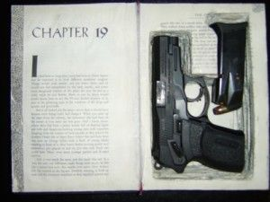 Hollow book safe conceals hand gun and ammo