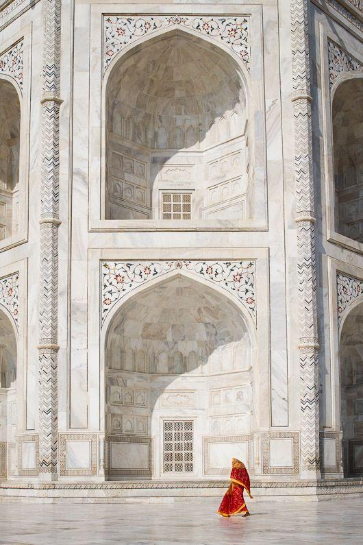 :  Woman walking in front of the Taj Maha, Agra, India by Simon Christen