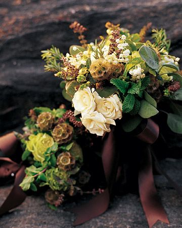 Fall is a beautiful time of year to have a wedding, whether you're planning the event around the colors of the season or not. We've gathered our favorite fall ideas from featured weddings to inspire you while putting together your own autumnal wedding.  Bride Fraser's bouquet takes a cue from the season and is a fragrant mix of white majolica roses, Scabiosa, sage, basil, rosemary, and lily of the valley. The bridesmaid bouquets are miniature versions.