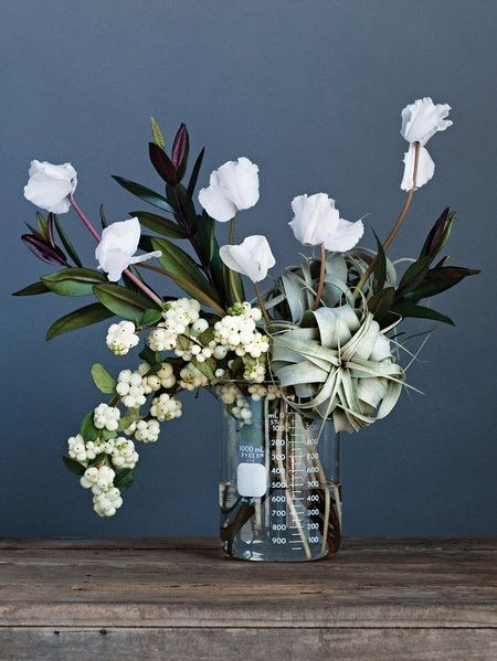 Modern floral arrangement in a glass beaker