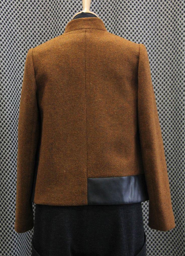 minimal cut jacket on a herringbone patterned wool fabric