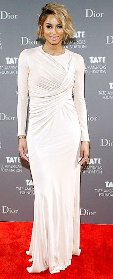 The singer looked stunning in a nude-colored long-sleeved gown at the NYC event on May 8.