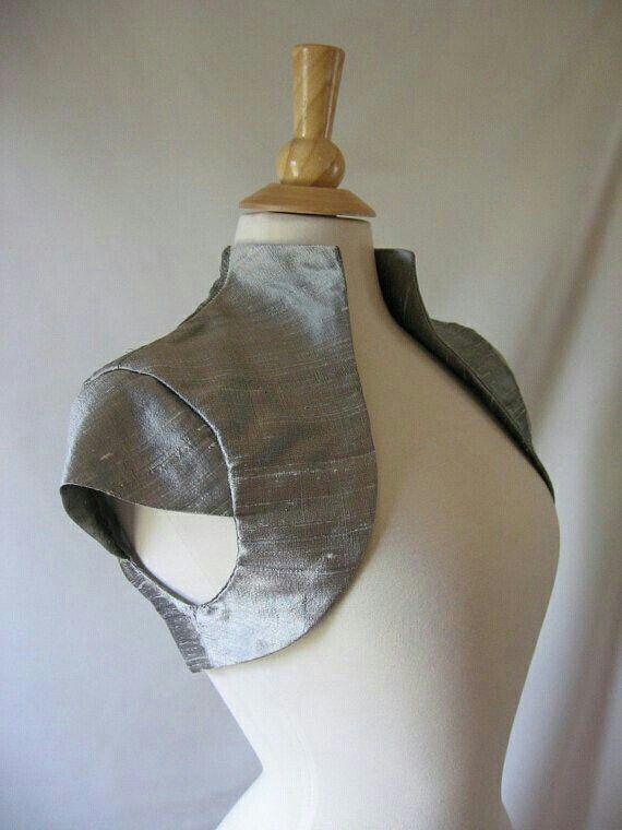 Gorgeous short sleeve silver  shrug bolero. As seen by  www.bolerojacketsandshrugs.com