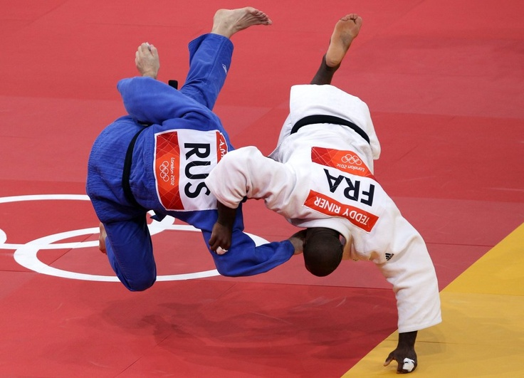 London 2012 - Teddy Riner of France, in white, defeated Alexander Mikhaylin in  judo.