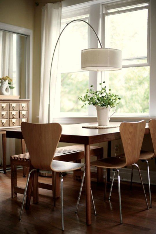 An Arc Lamp Illuminates the Dining Table Roomarks