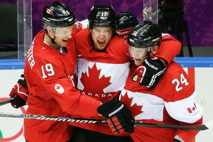 Jamie Benn celebrates his goal against the USA with Jay Bouwmeester and Corey Perry #Sochi2014 (AP Photo/Mark Humphrey)