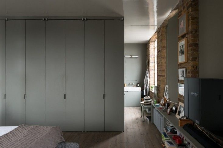 Ilse Crawford London Flat | Remodelista - a wall of closets separates the…