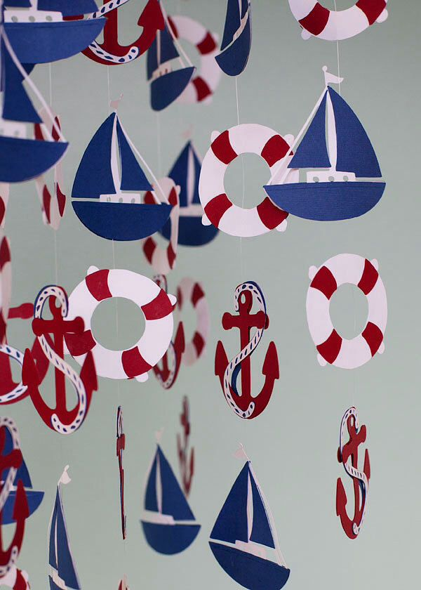 A personal favorite from my Etsy shop https://www.etsy.com/listing/170560174/nautical-mobile-in-red-blue-and-white
