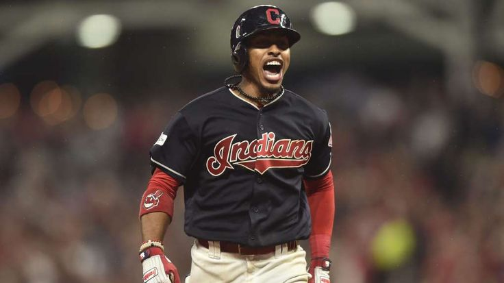 Francisco Lindor brings Indians back with monstrous grand slam   -  October 6, 2017:  Oct 6, 2017; Cleveland, OH, USA; Cleveland Indians shortstop Francisco Lindor (12) celebrates after hitting a grand slam during the sixth inning in game two of the 2017 ALDS against the New York Yankees at Progressive Field.