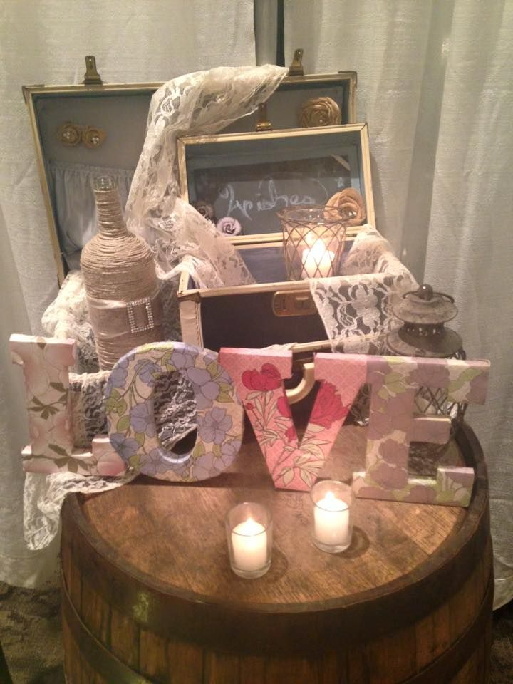 """We are in love with this """"love"""" themed table! It's perfect at a wedding entrance! Celebrate Party Rentals has everything your looking for to make your special day memorable! Click the image for more details. Photo credit: Celebrate Rentals Facebook"""