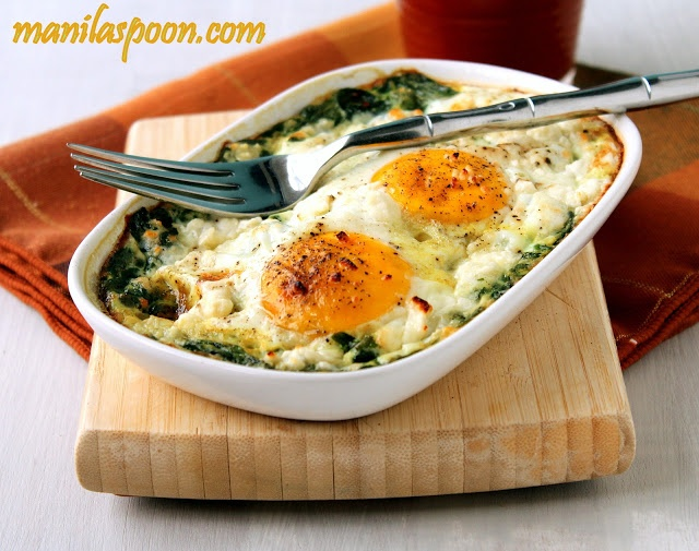 Baked Spinach and Eggs 6 cups firmly packed baby spinach or 1 (10 oz or up to 1 lb) bag fresh baby spinach*  4 eggs (can increase to 6 if you are using more spinach)  Salt and freshly Ground Pepper, to taste  1 Tbsp crumbled Feta Cheese for 1-2 eggs (about 2-3 Tbps in total)     Baking spray or a little oil for greasing