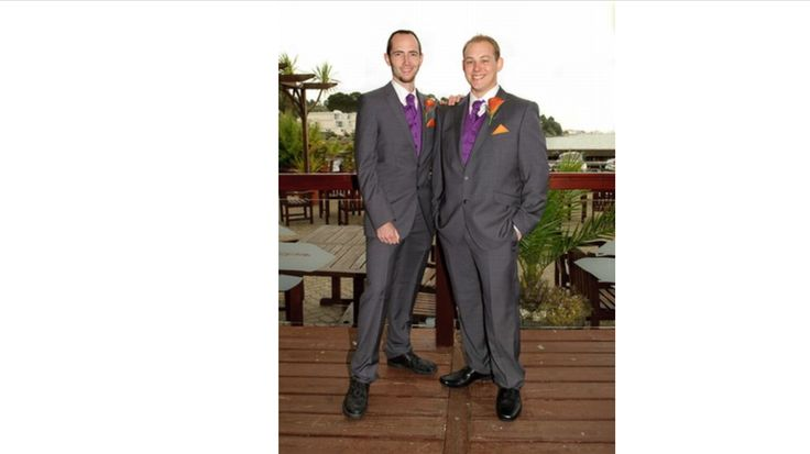 Groom and bestman and groomsmen in m&s suits and my tuxedo .co.uk waistcoats and cravats