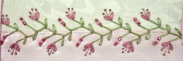 I ❤ beaded embroidery . . . TAST Week 49- The Knotted Feather stitch was done with 3 strands of floss. Pink detached chain flowers were also 3 strands of floss with Kreinik very fine braid pistil stitches. Green detached chain stitch leaves were done with 2 strands of floss & beads added the final details. ~By Susie W