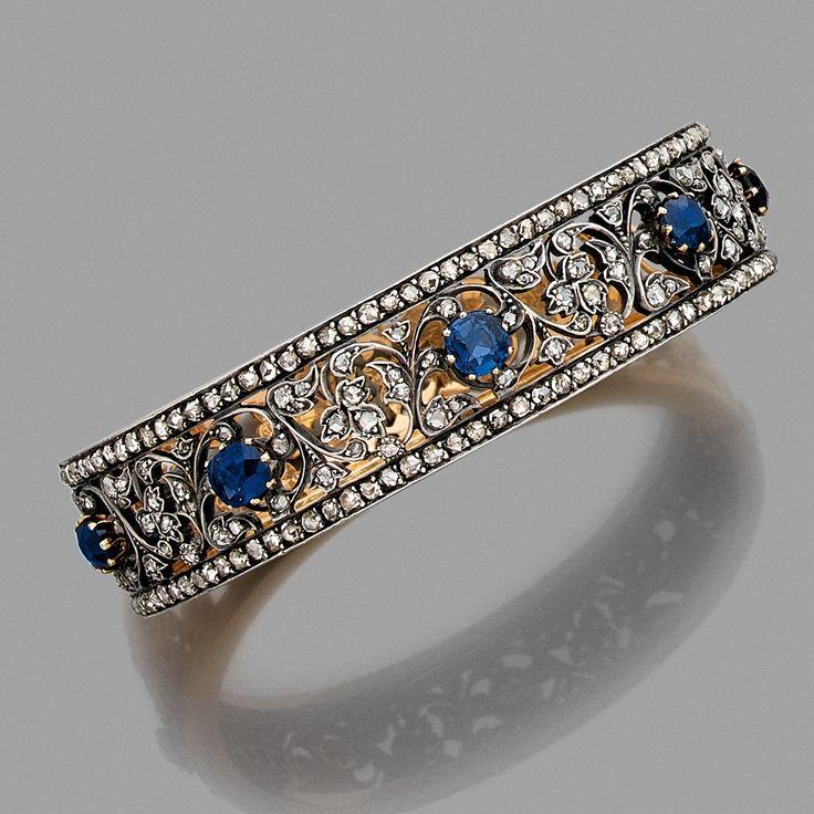 A sapphire, diamond, blue stone, gold and silver bangle by MELLERIO, circa 1880.
