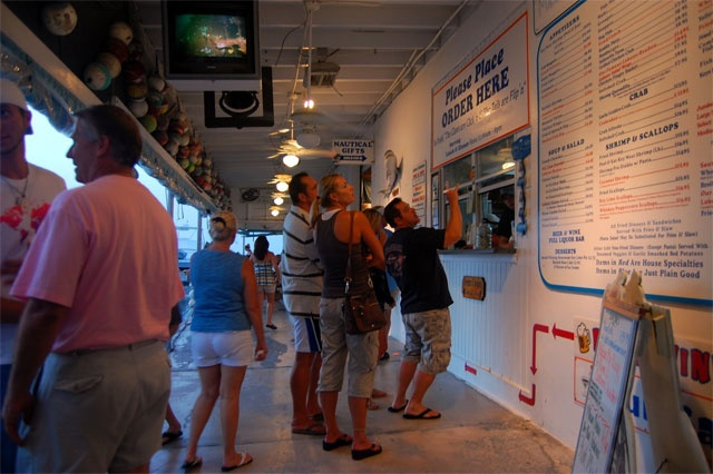A few miles north of the Seven Mile Bridge in Marathon, right around Mile Marker 49, sits a hidden hot spot for what could be the best seafood in Florida.