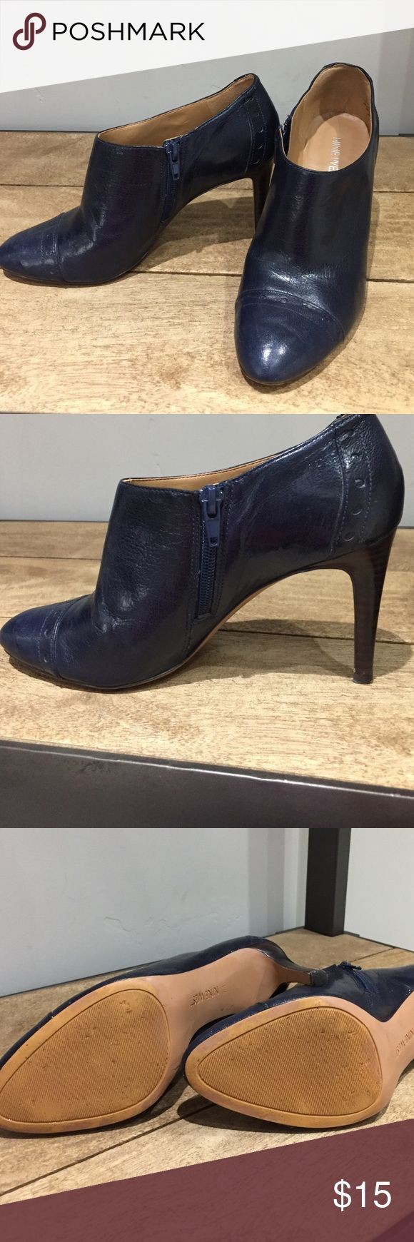 Navy ankle boots So cute. These ankle boots show some wear on the heal as shown but otherwise they are in great condition. Worn a handful of times. Nine West Shoes Ankle Boots & Booties