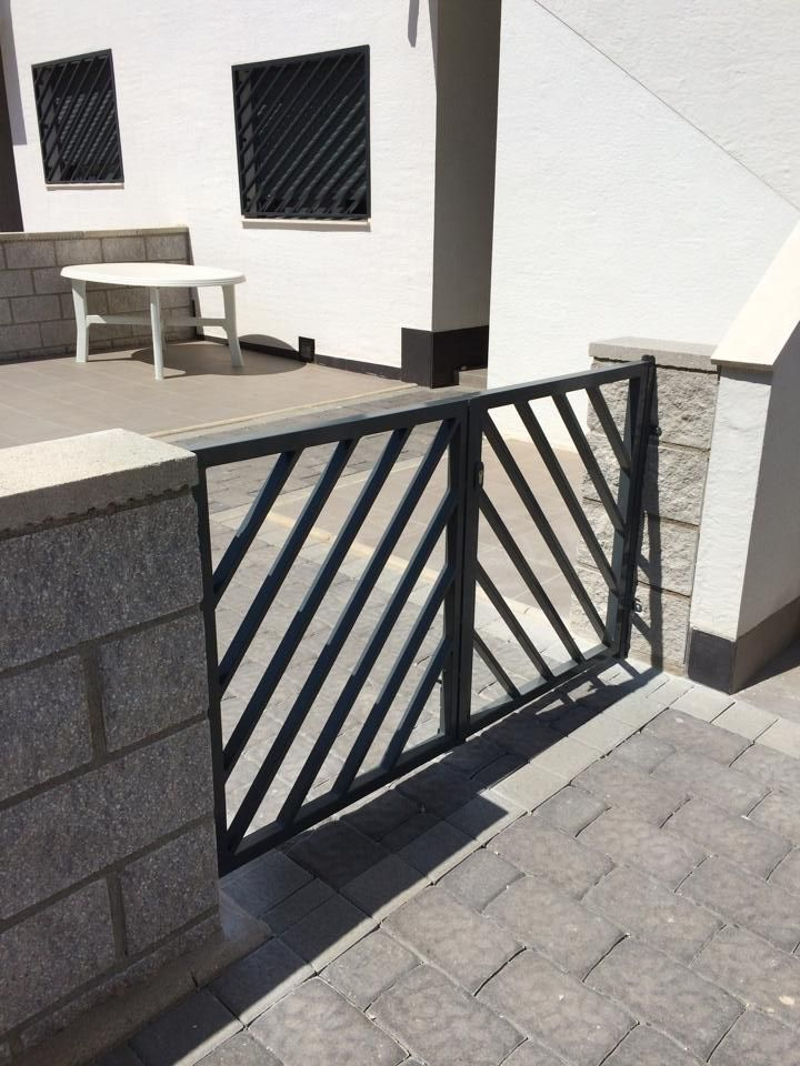 Metal gate to garden @ Oasis Beach - La Zenia