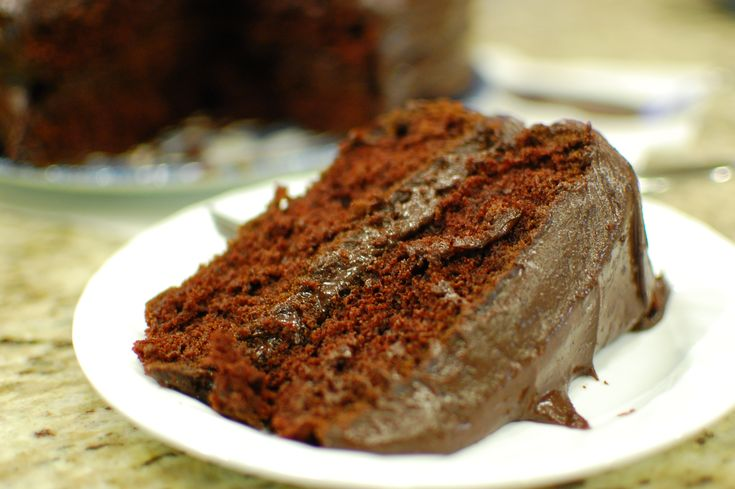 "Old Fashioned Chocolate Cake (a.k.a. ""Wacky Chocolate Cake"" or ""Depression Chocolate Cake"") - so easy to make with basic pantry ingredients, and the cake part is also vegan.  The frosting is easy too - no beating required! :)"