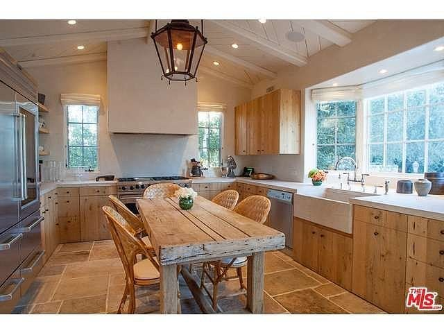 The Italian farmhouse-style kitchen features high-end appliances sure to satisfy even the most experienced of chefs.