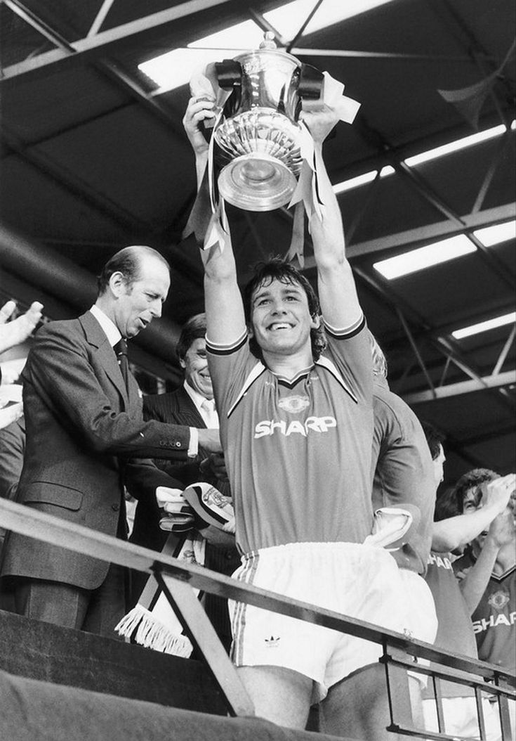 Bryan Robson lifts the FA Cup after victory over Everton in 1985