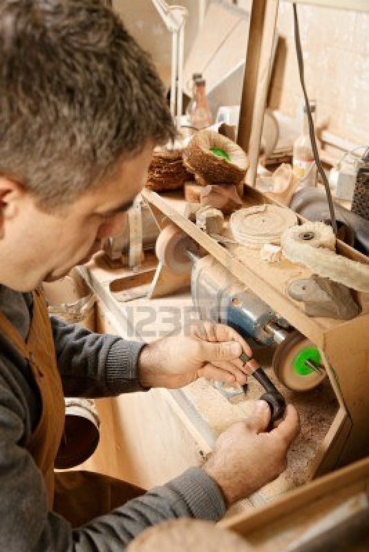 Craftsman working on grinder finishing a smoking pipe - great eye for detail - Stock Photo - 16054323
