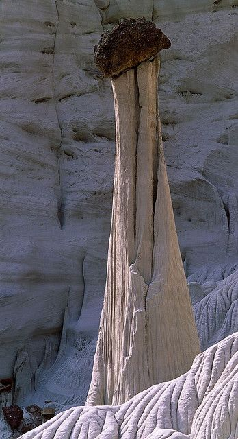 Tower of Silence. One of the Wahweap Formation Hoodoos in the Grand Staircase-Escelante National Monument is a geological formation in southern Utah and northern Arizona, around the Lake Powell region.