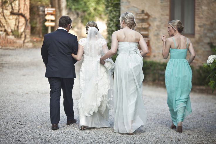 The bride, her father and her bridesmaids.