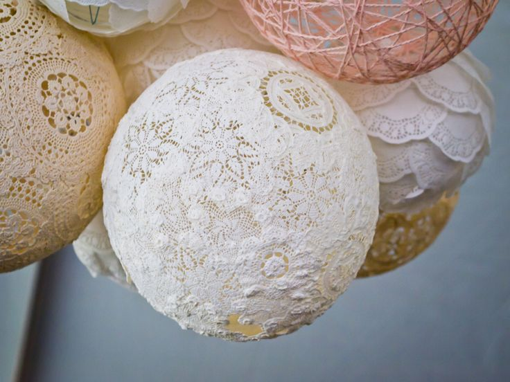 Beautiful lace balls. an alternative to snowflakes. Add a little interest to that long corridor.