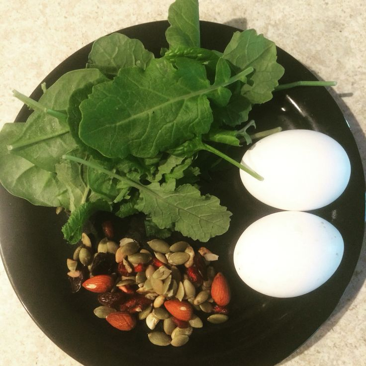 Quick meal: hardboiled eggs, almonds, pumpkin seeds, dried cranberries, kale and spinach.  #fit #nutrition #sportsnutrition #fitness #healthyfood #muscle #strong #strength #conditioning #powerlifting #weightlifting #bodybuilding #eatclean #food #mealprep #cleaneating #dempseysresolutionfitness
