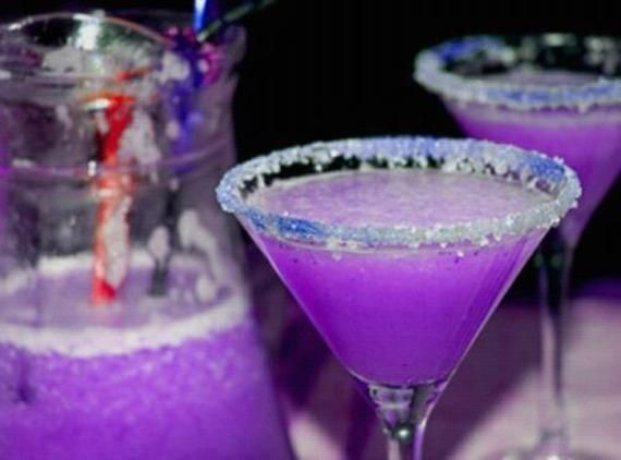Purple Dragon Martini [Mix 3 oz vodka, 1.5 oz cranberry juice, 1.5 oz blue curacao, 1.5 oz sweet and sour, .5 oz lemon-line soda with ice in a shaker glass; Dip martini glass into purple sprinkles; Strain into glass]