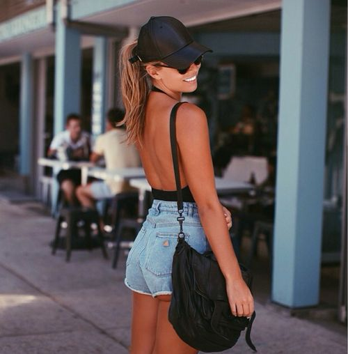 Backless top with golden tan and denim shorts    winner