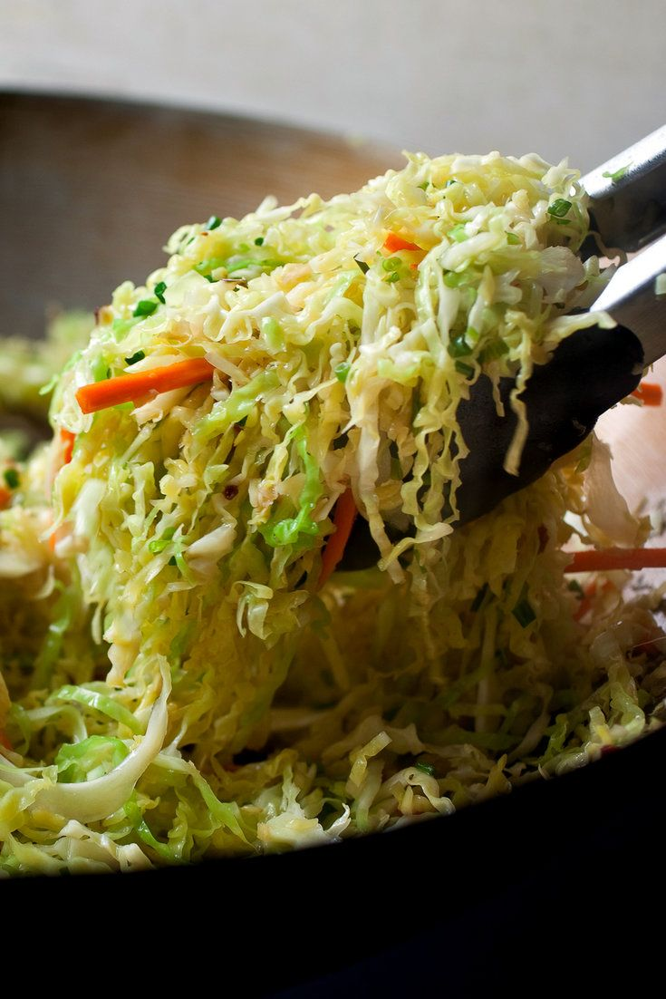 NYT Cooking: This is a vegetarian version of a classic Chinese stir-fry. The authentic versions I've encountered include some pork or bacon, but the chilies, ginger, garlic, star anise and the cabbage are flavorful enough without meat. I've added carrots for color. #Cabbage #Stir_Fry #Healthy #Savory