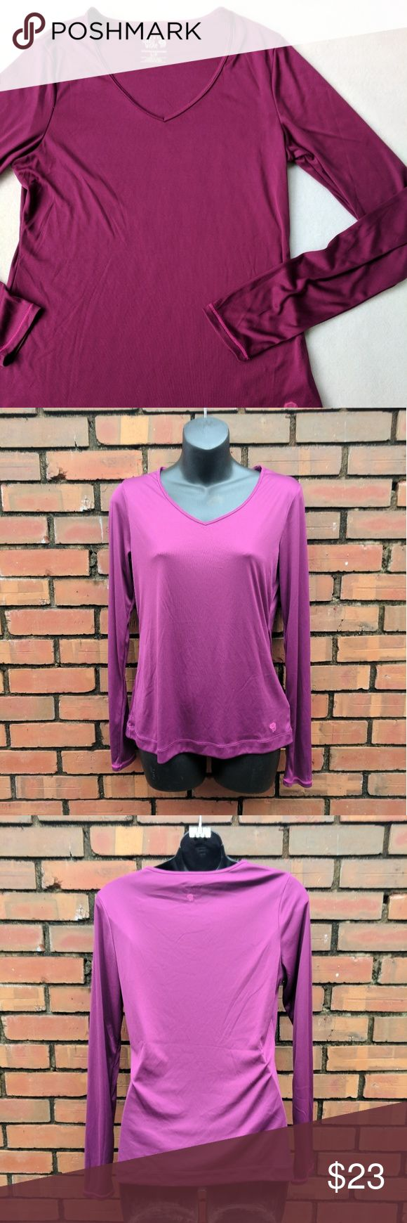 Mountain Hard Ware Women's Long Sleeve Wicked Tee Pre-owned but in excellent like new condition. No flaws or visible wear. A great pinkish purple color. Please see pictures above for exact measurements.   Offers are always welcome!  E&T Mountain Hard Wear Tops Tees - Long Sleeve