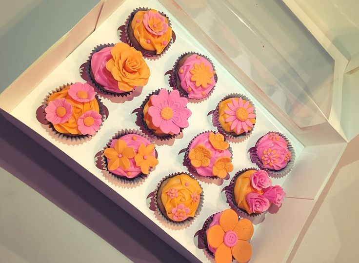 Pink and orange pretty flower cupcakes! So bright and elegant.   Check out my page https://www.facebook.com/frosted.cupcakes.invercargill/