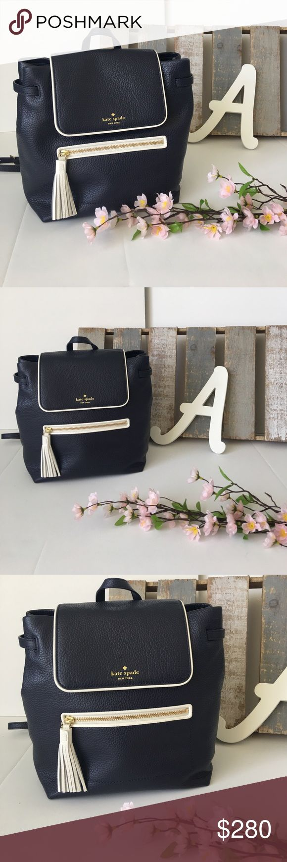 """Kate Spade """"Kacy"""" Backpack Navy Blue and White Kate Spade """"Kacy"""" backpack. Has front zipper pocket, inner zipper pocket, and two regular pockets. A bunch of room. So cute and originally $380!!! Brand new with tags and Kate Spade Care Guide. kate spade Bags Backpacks"""