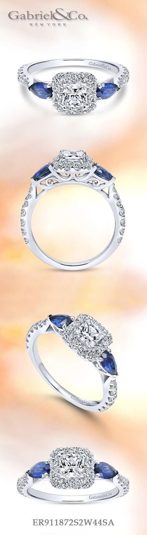 Gabriel NY - Preferred Fine Jewelry and Bridal Brand. 14k White Gold Princess Cut Halo Engagement ring. In this captivating white gold engagement ring, a pair of deep blue pear cut sapphires frame a princess cut diamond in a diamond halo. Find your nearest retailer-> https://www.gabrielny.com/storelocator